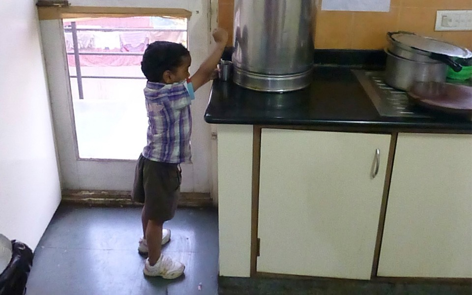 RAVI---IN-bh-child-getting-water
